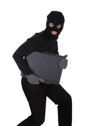 Thief stealing a laptop